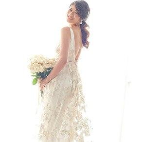 """""""幸福が訪れますように"""" ひと針ひと針に願いを込めた 世界に一着の手縫いドレス"""